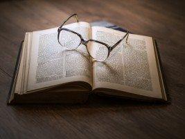eyeglasses-on-open-book