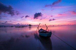 boat-on-lake-at-sunrise